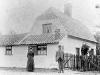 232-bui : Mr. and Mrs Barnett outside Pear Tree Cottage, Barton Road (c. 1900)